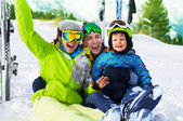 Family sitting on snow — Stock Photo