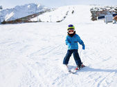 Boy  learns skiing — Foto Stock