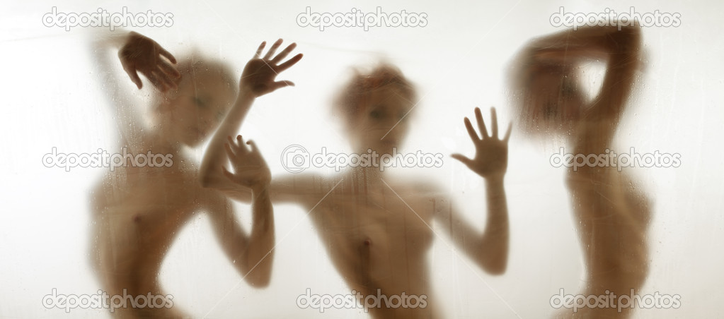 ... silhouettes of a woman in shower in shower behind the curtain