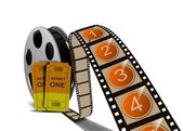 Movie film reel and tickets — Stock Photo