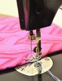 Sewing machine and textile — Stock Photo