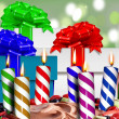 Birthday candles on a cake and gift boxes — Stock Photo #27685195