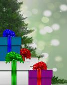 Stack of gift box by Christmas tree — Stock Photo