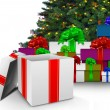Christmas presents by tree — Stock Photo