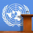 Stock Photo: Podium and United Nation flag