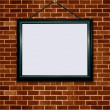 Picture frame on brick wall — 图库照片
