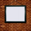 Foto Stock: Picture frame on brick wall