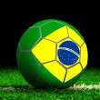 Soccer Ball with Brazilian Flag on Grass — Stock Photo