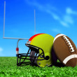 Football Ball and Helmet On Grass — Stock Photo