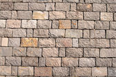 Stone wall made of regular oblong pieces — Stock Photo