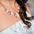 Adornment on neck of young bride — Stock Photo