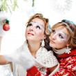 Girls with christmas ball — Stock Photo