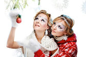 Girls with christmas ball — Stok fotoğraf