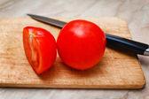 Ripe tomato cut segment on board — Stock Photo