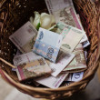 Stock Photo: Basket of money