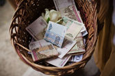 Basket of money — Stock Photo