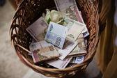 Basket of money — Stock Photo
