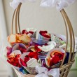 Foto Stock: Rose petals wrapped in paper