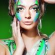 blond woman with colorful makeup — Stock Photo