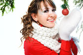 Girl holding christmas ball — Stock Photo