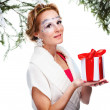 Woman with present wrapped in white paper — Foto de Stock