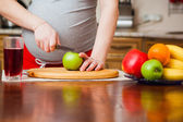 Beautiful pregnant woman on kitchen — Stock Photo