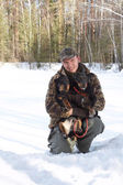 The man holds on hands of two hunting dogs Jagdterriers in the w — Stock Photo
