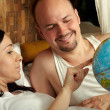 Stock Photo: Married couple discusses trip on holiday, considering the