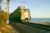 Passenger train on the sea background — Stock Photo