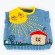 Children's knitted vest with house in the sun — Stock Photo