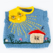 Stock Photo: Children's knitted vest with house in sun