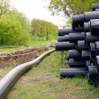 Stock Photo: Underground utilities - installation of plastic pipes