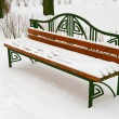 Stock Photo: Snow covered bench in winter park