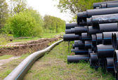 Underground utilities - installation of plastic pipes — Stock Photo
