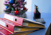 Office folders on background of Christmas tree — Stock Photo