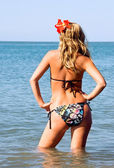Girl is standing knee-deep in the sea — Stock Photo
