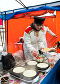 Street vending pancakes on Shrove Tuesday — Stock Photo