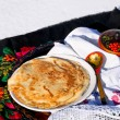 Pancake pancakes in the Russian style in the snow — Stock Photo
