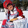 Russian woman in sundress with pancakes. Maslenitsa — Stock Photo