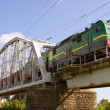 Stock Photo: Freight train going over bridge
