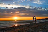 Sunset on coast of the sea — Stock Photo