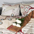 Stock Photo: Bed and bedding: pillows and blankets