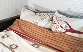 Bed and bedding: pillows and blankets — Stock Photo
