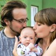 Young family with bab — Stockfoto
