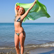 Girl with green scarf on sea beach — Stock Photo