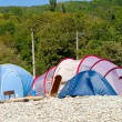 Tents on the pebbles. Camping and caravans — Stock Photo