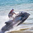 Stock Photo: On water bike through waves