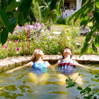 Two women are swimming in the pool at their summer cottage — Stock Photo