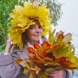 Cheerful woman with bouquet maple autumn leaves — Stock Photo #31176149