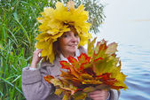 Cheerful woman with bouquet maple autumn leaves — Stock Photo